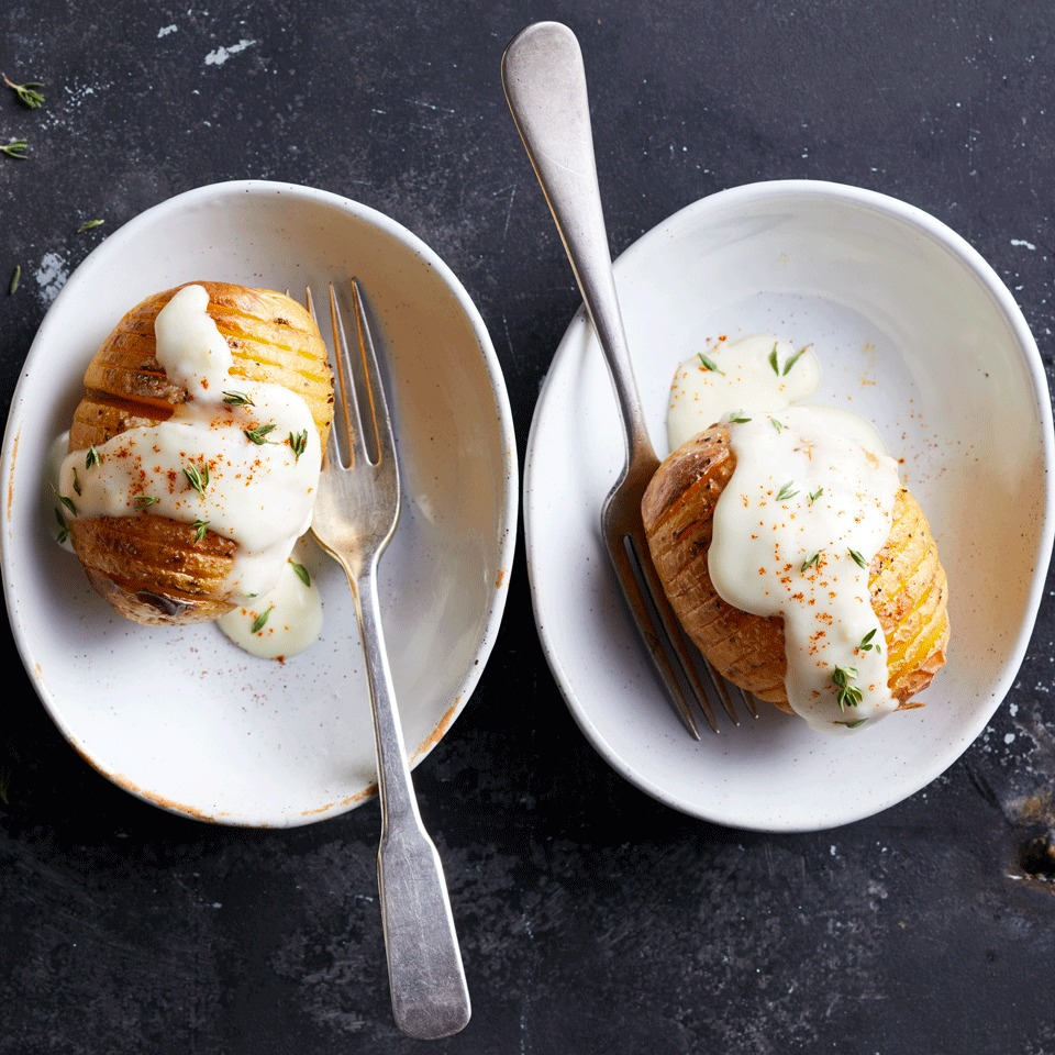 It's potato nirvana—crispy hasselback potatoes topped with the creamy sauce you'd make for scalloped potatoes. The perfect portions in this fun riff on a scalloped potato casserole make an impressive (but easy to achieve) presentation as a side dish.