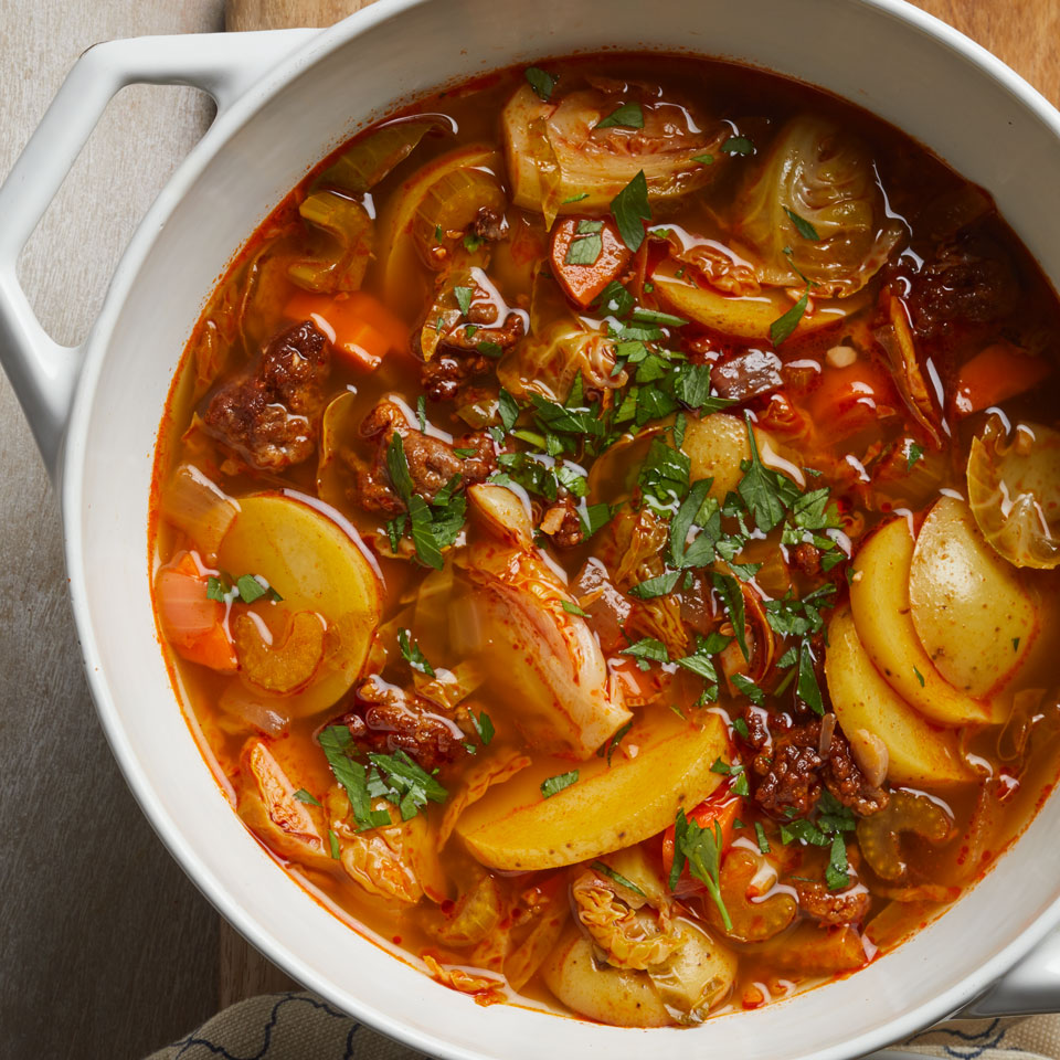 Bake up some Manchego cheese toasts and uncork a bottle of Ribera del Duero to enjoy alongside this healthy pot of soup. Both sweet and hot Italian sausage work well.