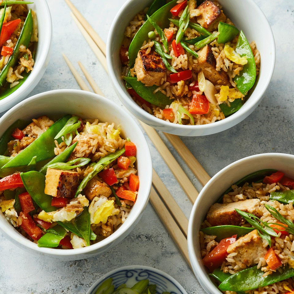 Next time you're craving Chinese takeout, make this veggie-packed fried rice recipe in about the same time instead. Tofu and eggs give this vegetarian fried rice staying power from protein, and brown rice boosts fiber.
