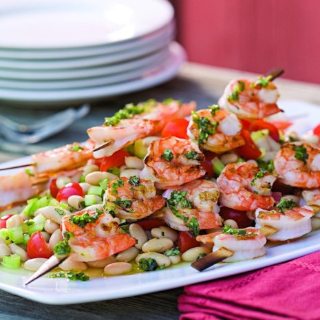 Grilled Shrimp Skewers over White Bean Salad