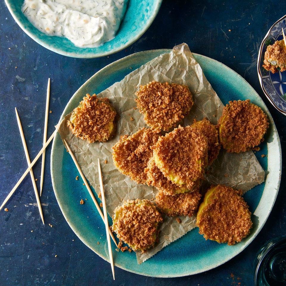 These oven-fried pickles get their crispy exterior from a dredge in flour, egg and whole-wheat breadcrumbs. Serve with a creamy herbed sour cream to take this easy app to the next level.