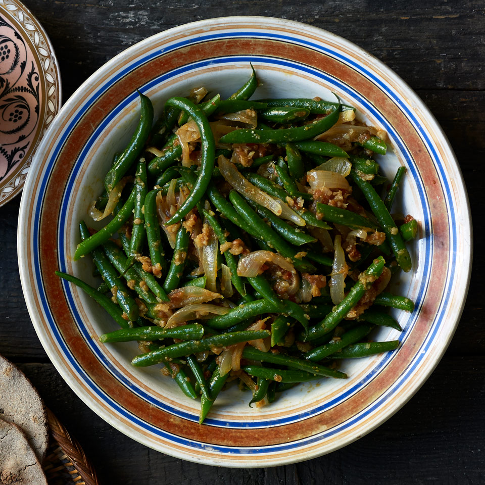 Like many Ethiopian dishes, this green bean side dish recipe has endless variations depending on who's cooking it. Green beans are always the star, most often along with carrots and rosemary, though it can also be served with potatoes or cabbage.