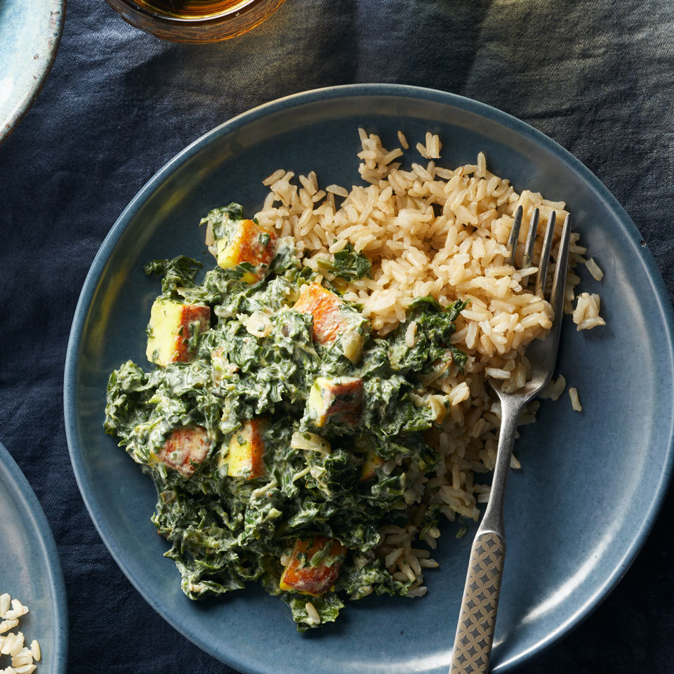 The paneer cheese in this fast and easy dinner doesn't melt when it cooks. It browns instead, giving a toothsome texture to this Indian classic packed with spinach and spices. Serve over brown basmati rice to round out this healthy meal.