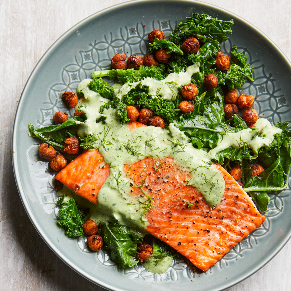 In this healthy salmon dinner, you'll get a dose of greens and green dressing! Chowing down on 6 or more servings of dark leafy greens a week can help keep your brain in top shape. This dish features the Test Kitchen's current go-to method for doctoring a can of chickpeas: spice them up and roast until crispy. Pair with quinoa for a complete meal!