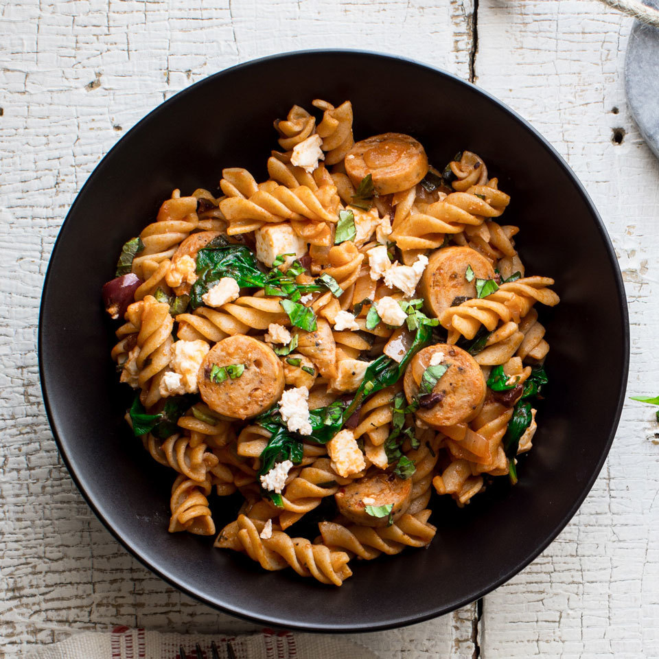 A little bit of Sunday meal prep goes a long way in this one-dish Mediterranean pasta recipe. The pasta is cooked ahead of time and stored in the fridge to use for meals all week, but any leftover cooked pasta you have on hand will do. Chicken sausage with feta is especially good in this recipe.