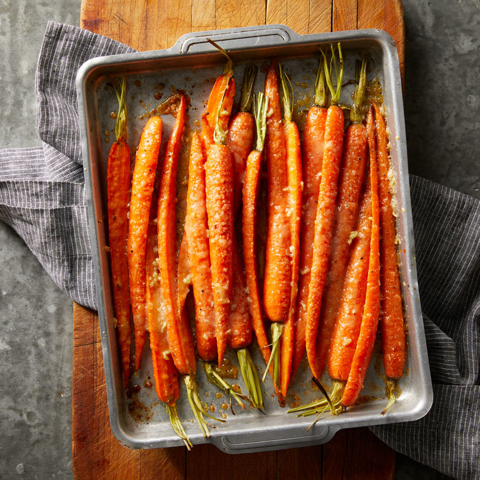 Roasting carrots in the oven brings out their inherent sweetness, while Parmesan and garlic give this easy side dish a flavorful savory accent.