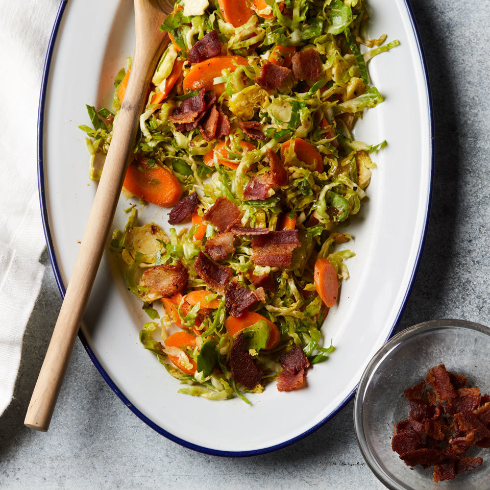Slicing Brussels sprouts thinly creates the perfect texture for this raw salad that's made even more flavorful thanks to a little bacon. This easy side dish is perfect for a potluck.