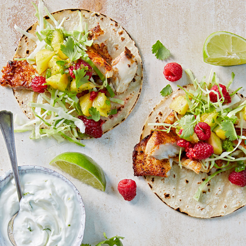 This refreshing version of traditional fish tacos features a lively raspberry-pineapple salsa and a yogurt-lime cream sauce.