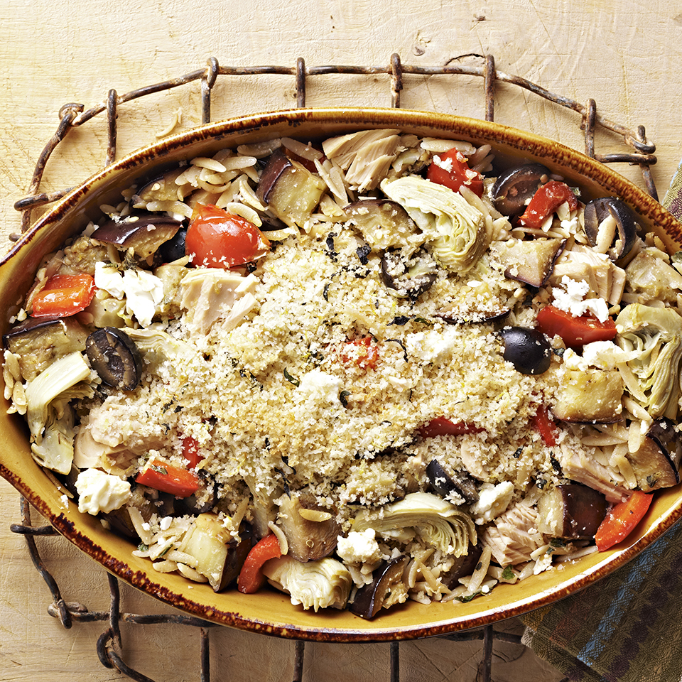 Tuna casserole is a timeless comfort-food recipe; this one incorporates eggplant, artichoke hearts, oregano, olives and feta cheese for a Greek flair.