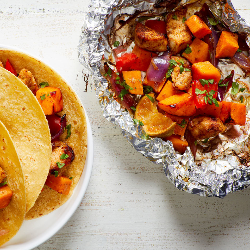 Cook your whole meal in a packet on the grill with this easy veggie-loaded recipe. The Mexican-inspired seasoning makes the chicken and veggies taste great served with warm tortillas and your favorite taco toppings for a healthy dinner.