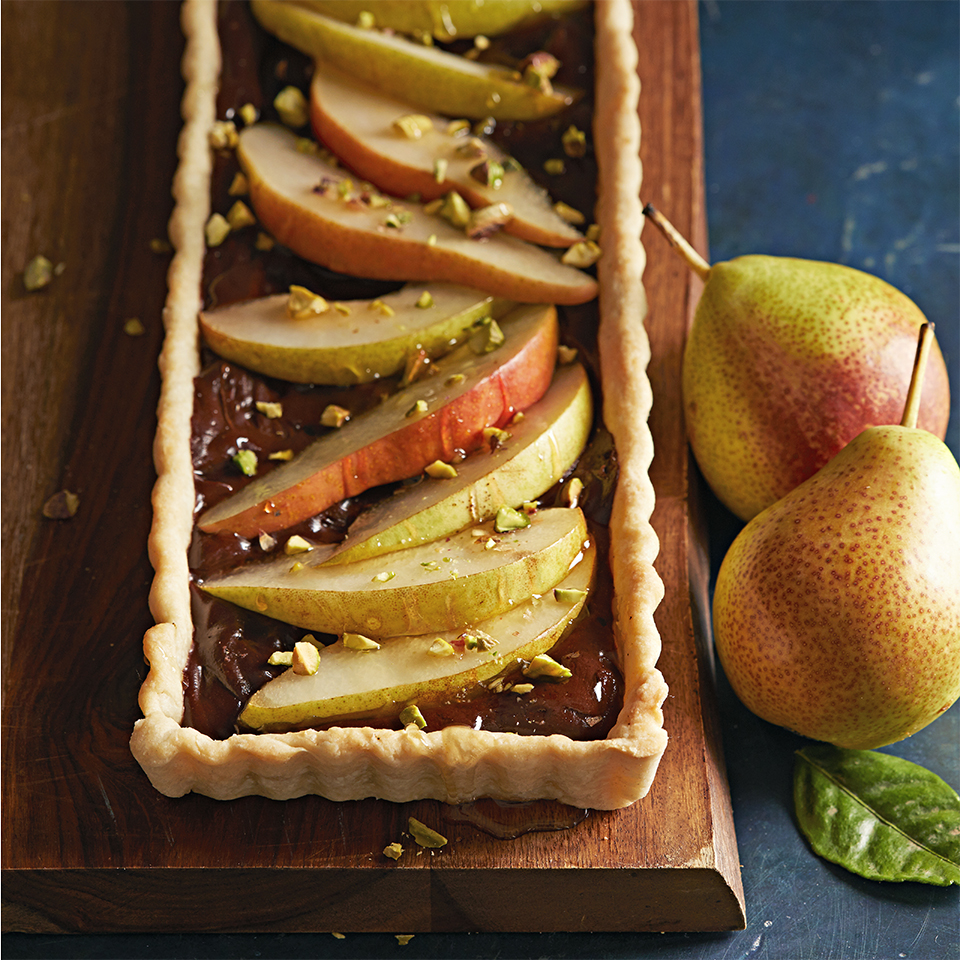 Drizzled with honey and sprinkled with pistachios, this diabetic-friendly, chocolate-pear tart is sure to please.