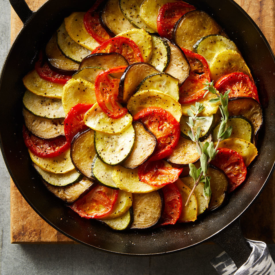 Ratatouille, a classic French dish with tomatoes, eggplant, zucchini, bell pepper and onion, is frequently cooked low and slow until it turns silky and luscious. We kept the classic flavor but gave it a makeover by thinly slicing the vegetables and layering them in a cast-iron pan. We brighten up the flavor at the end with a splash of red-wine vinegar.