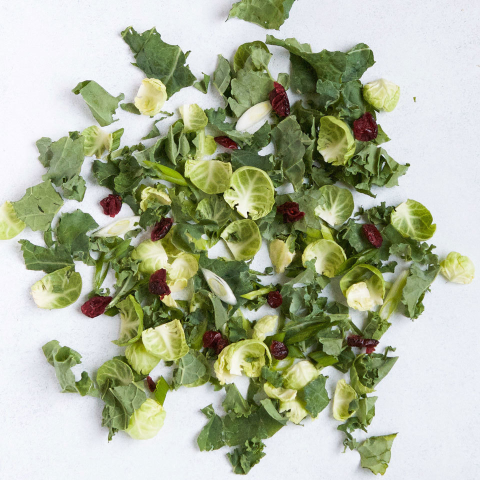 Hearty greens and vegetables like kale and Brussels sprouts make an excellent base for prep-ahead salads. They don't wilt after a day in the crisper, and they stand up to any number of toppings. Bonus: They're loaded with nutrients, vitamins and minerals you won't get from your basic iceberg wedge. The sweetness of dried cranberries balances the slight bitterness of the greens and scallions—a combo that makes for a festive read and green salad!
