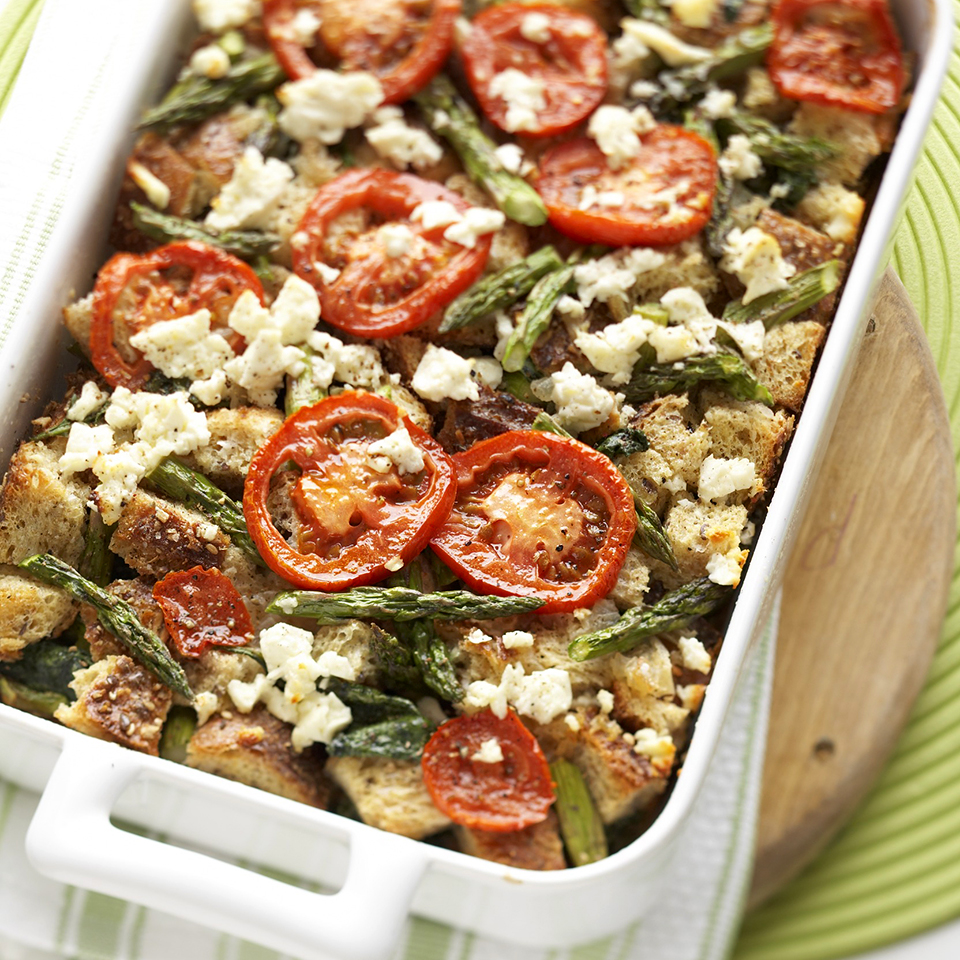 A colorful, delicious bake of eggs and whole wheat bread layered with asparagus, spinach, tomatoes, and feta cheese makes a special breakfast or brunch entree. Best of all, you make it ahead of time.