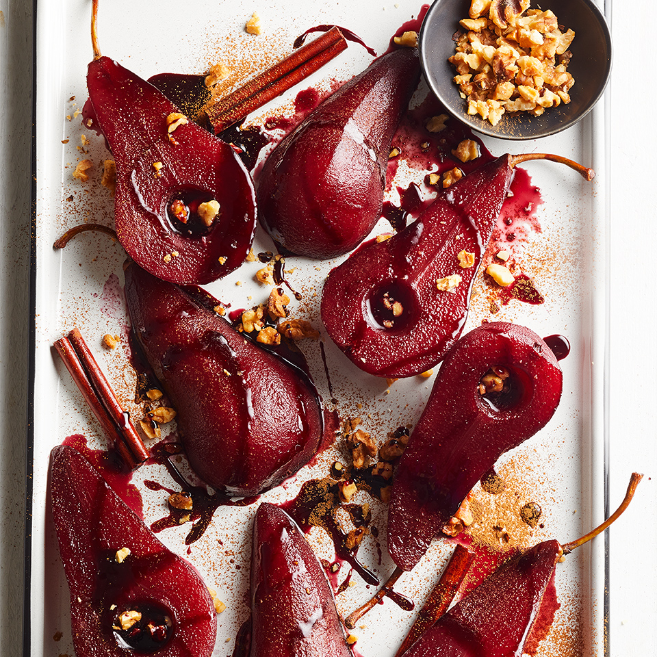 Looking for a unique and delicious dessert? These spicy-sweet pears are poached in red wine, served with a pomegranate syrup and sprinkled with walnuts and cinnamon