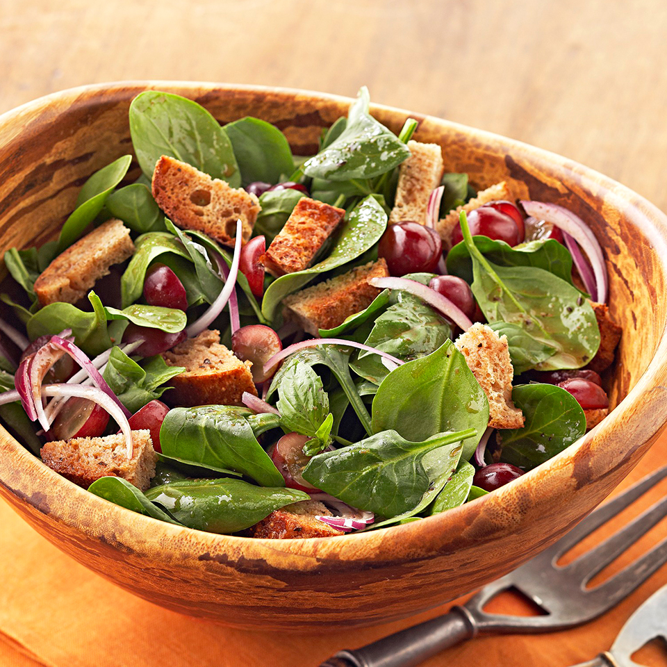 This version of Panzanella—a popular Tuscan salad— uses whole-grain bread, baby spinach and a reduced-calorie balsamic dressing for a healthier twist.