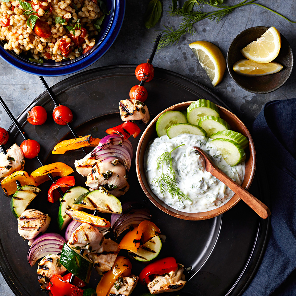 This recipe combines two popular components of Greek cuisine: souvlaki and tzatziki. Souvlaki consists of skewered, grilled meat, and tzatziki is a yogurt-based sauce traditionally served with grilled meats.