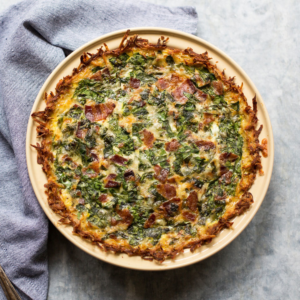 Hash browns meet quiche in this healthy recipe. Shredded potatoes create a gluten-free crust for this bacon and spinach-studded quiche that's sure to be a crowd-pleasing breakfast or brunch.