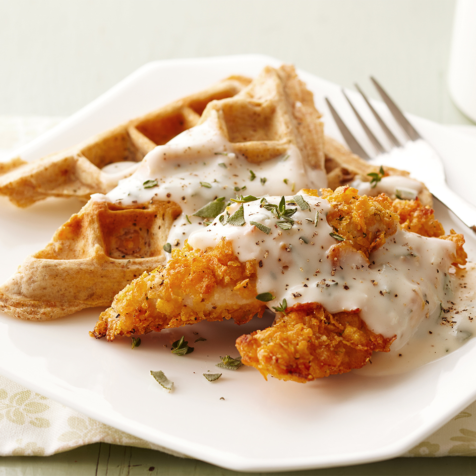 Waffles aren't just for breakfast anymore! This savory variation with crispy chicken and a delicious herb gravy is comfort food at its best.