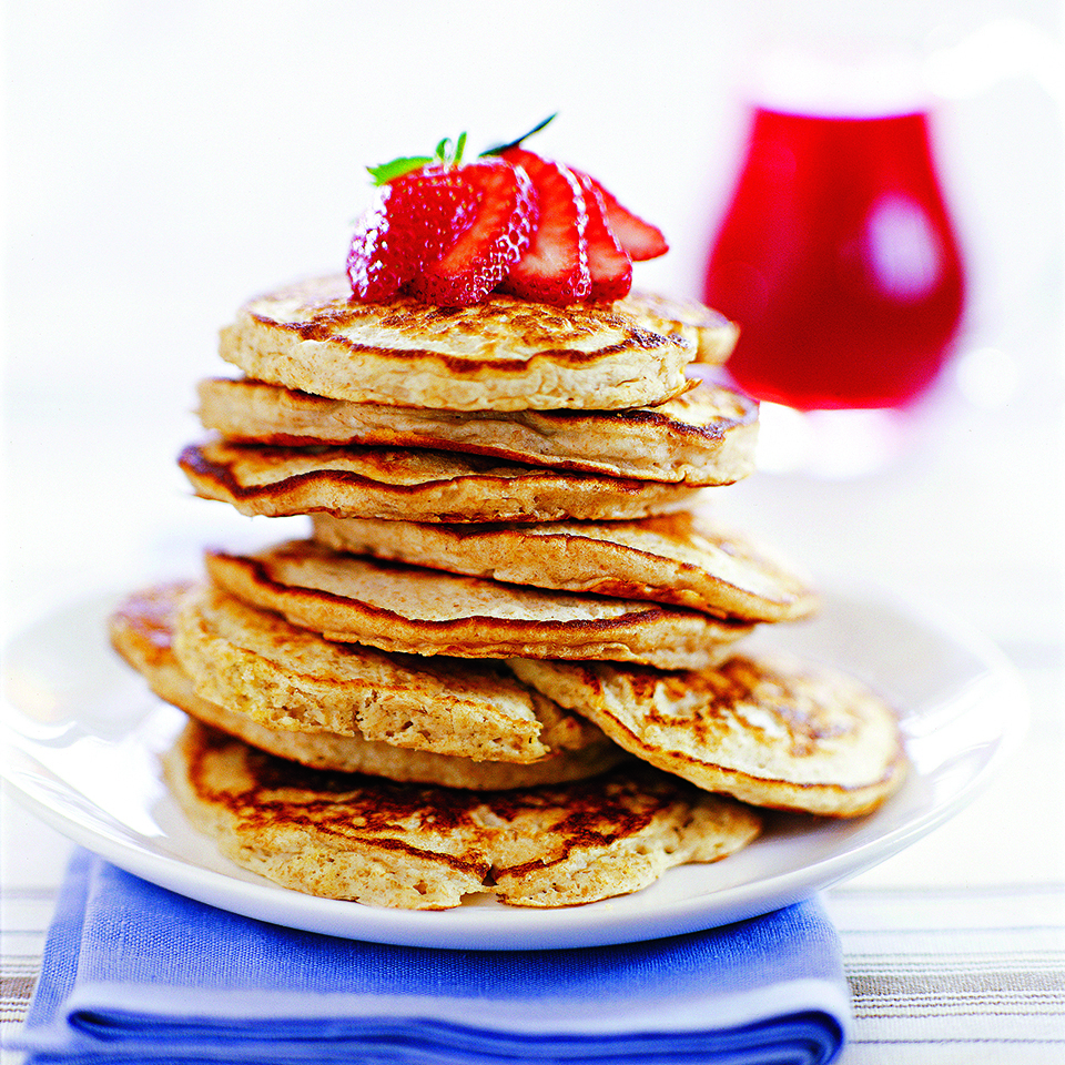 These whole-wheat and oat pancakes are filling and a great choice for a weekend breakfast. The pear sauce with a hint of maple adds the crowning touch.