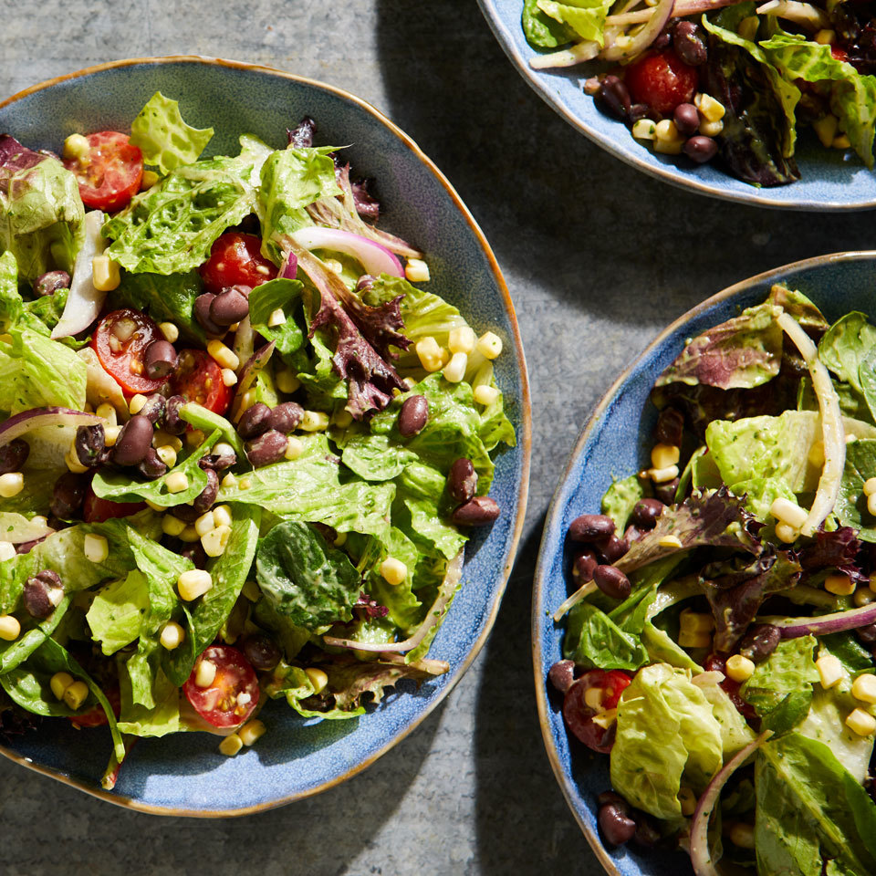 This vegan black bean salad version gets its creaminess from blended avocado. Any mix of salad greens will work well, but try arugula if you want to give this hearty salad a peppery kick.