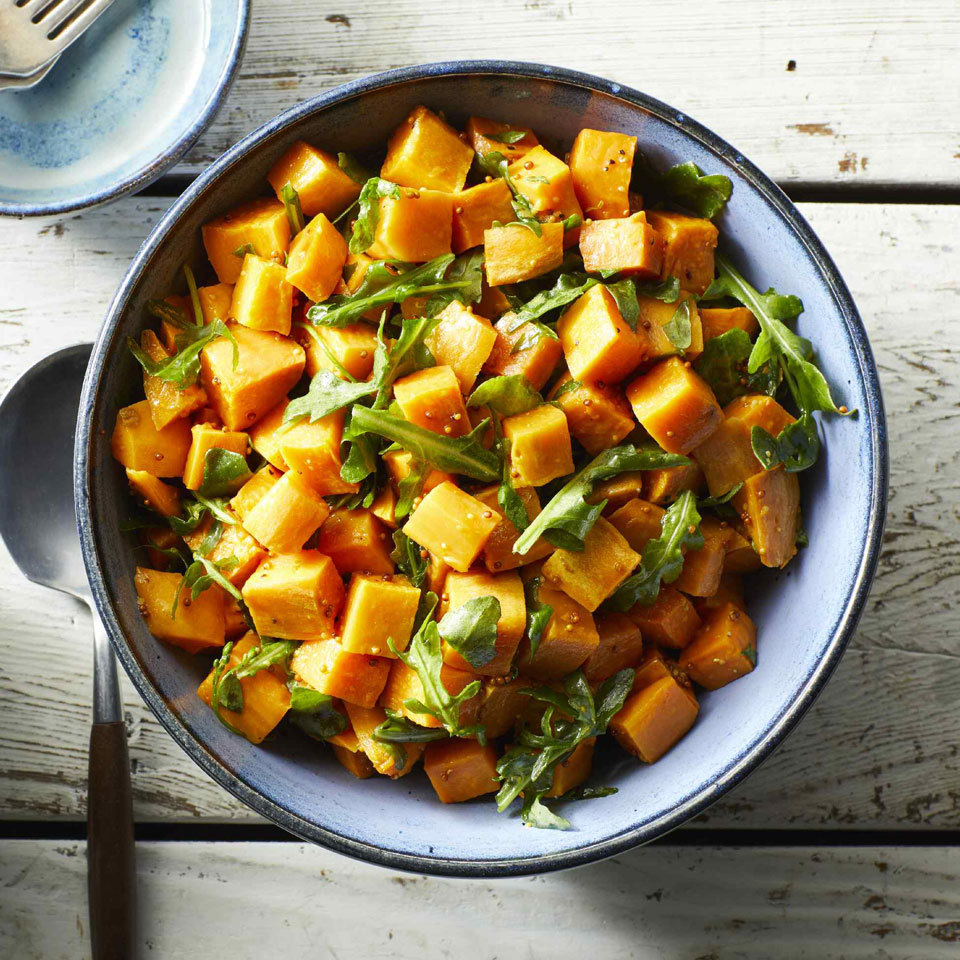 Give traditional potato salad a fresh spin with sweet potatoes, peppery arugula and a tangy-sweet dressing. This crowd-pleasing side dish is also versatile; you can add ingredients you prefer in potato salad, like green onions. Enjoy at room temperature or chilled.