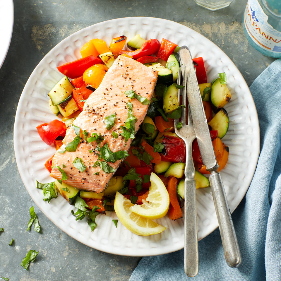 Grilled salmon and veggies make for a colorful and balanced seafood dinner that's ready in just minutes. The grill turns the salmon flaky and moist while tenderizing the crispy pepper and onion pieces. Round out the meal with brown rice or quinoa.