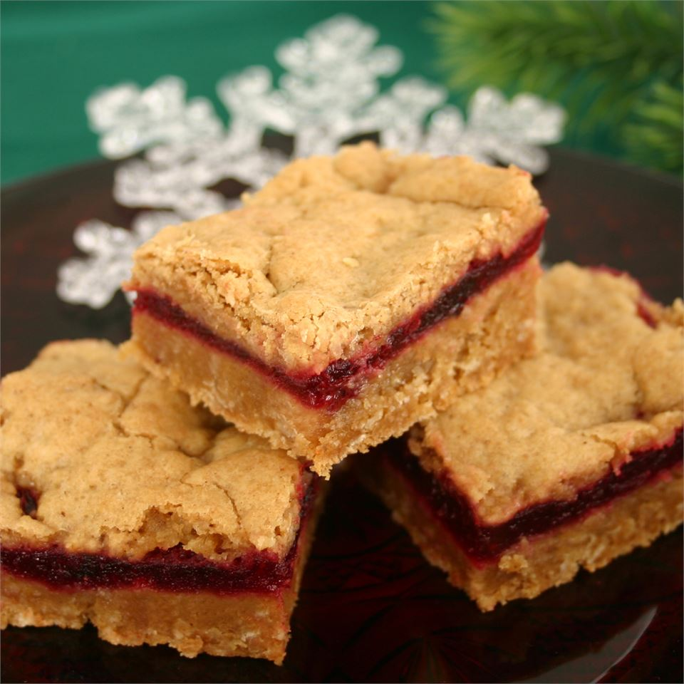 Although not a traditional Thanksgiving dessert, bars make for an easy dish that's portable and perfect for retiring away from the dinner table. Fresh cranberries are cooked down into a sweet and tangy syrup before being layered in between spiced vanilla batter. If only frozen cranberries are available, they can be used but reduce the water by 1/4 cup.