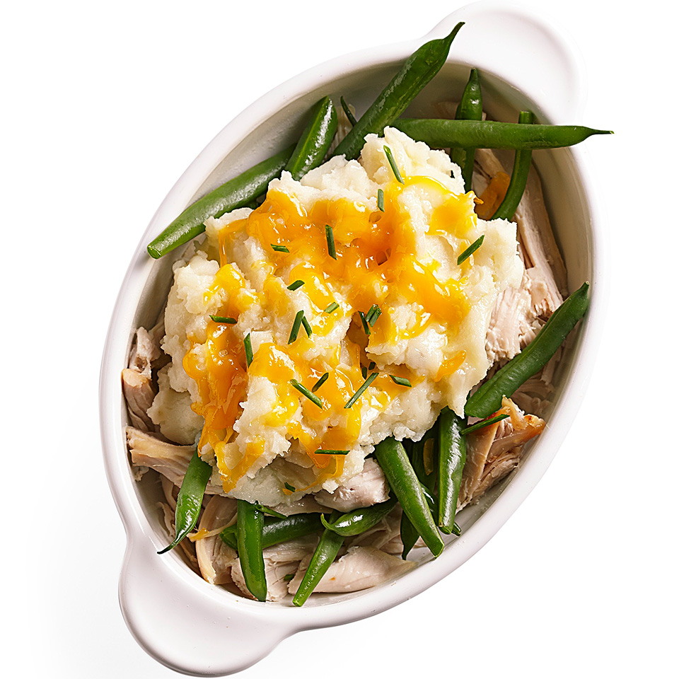 In this simple dish, shredded turkey, green beans and mashed potatoes are layered and topped with reduced-fat Cheddar cheese. It's a great way to use leftovers from your holiday meal!