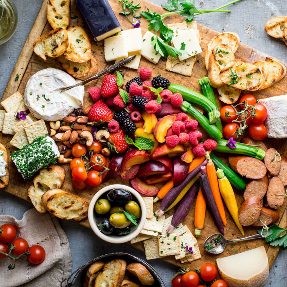 This easy cheese board features a bounty of seasonal vegetables and fresh fruits, which add color and complement the variety of cheeses. We've made cheese suggestions, but feel free to mix and match with your favorites. For the fresh produce, improvise based on what's available at your market and what's in season.