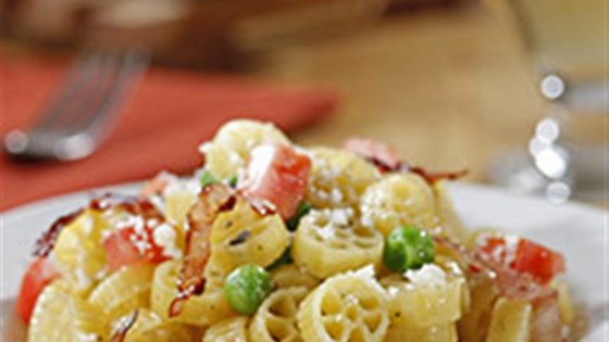 Photo of Mini Wheels with Peas, Ham and Tomato by Barilla