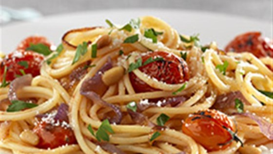 Photo of Gluten Free Spaghetti with Caramelized Red Onions, Cherry Tomatoes, Pine Nuts, and Pecorino Cheese by Barilla