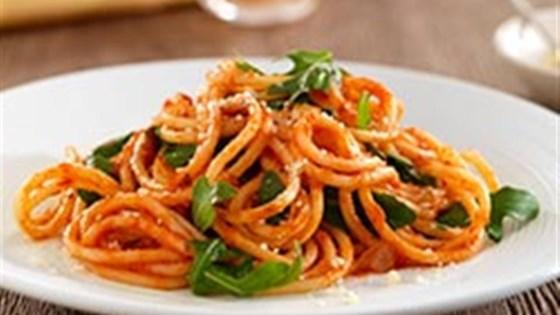 Photo of Thick Spaghetti with Marinara Sauce, Arugula and Parmigiano Cheese by Barilla