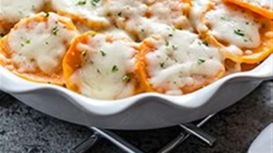 Photo of Scalloped Herb and Garlic Sweet Potatoes by KRAFT Shredded Cheese with a TOUCH OF PHILADELPHIA