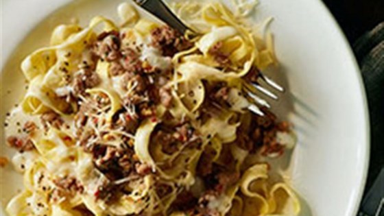 Photo of Fettuccine and Sweet Italian Sausage with Light Alfredo Sauce by Buitoni