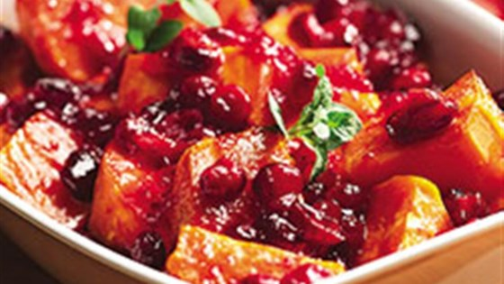 Photo of Cranberry Orange Sauced Sweet Potatoes by Crisco