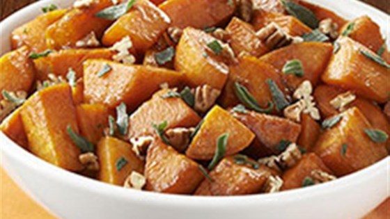 Photo of Molasses Glazed Sweet Potatoes with Sage & Pecans by Crisco