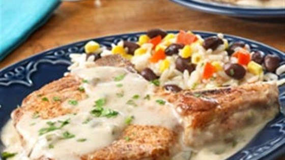 Photo of Pork Chops with Creamy Poblano Sauce by Campbell's Kitchen
