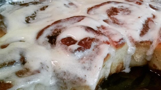 Photo of The Perfect Cinnamon Roll Icing by Cara McGuire