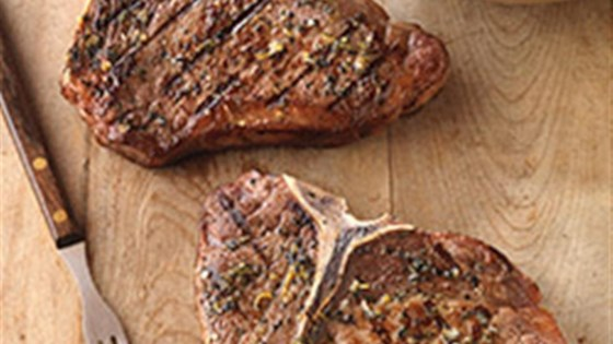 Photo of Greek-Seasoned T-Bone Steaks with Cucumber and Tomato Salad by Beef. It's What's For Dinner.