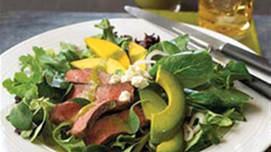 Photo of Pepper Steak Salad with Mango, Avocado and Jalapeno Vinaigrette by Beef. It's What's For Dinner.