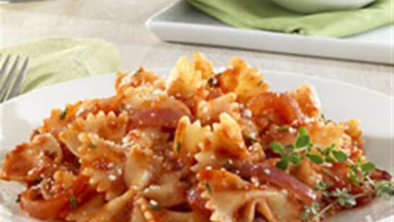 Photo of Barilla® Farfalle with Red Onions, Tomatoes, Thyme and Parmigiano Reggiano Cheese by Barilla®