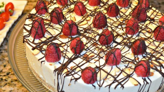 Photo of Laurie's Amaretto Mousse Cheesecake by LGEREMIA