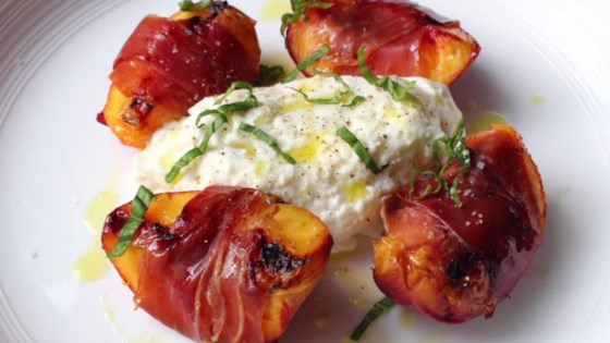 Photo of Grilled Prosciutto-Wrapped Peaches with Burrata and Basil by Chef John
