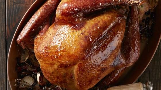 Photo of Roast Turkey with Cranberry and Pomegranate Glaze by Reynolds Kitchens®