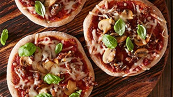 Photo of Sausage and Mushroom Mini Pizzas by Reynolds Kitchens®