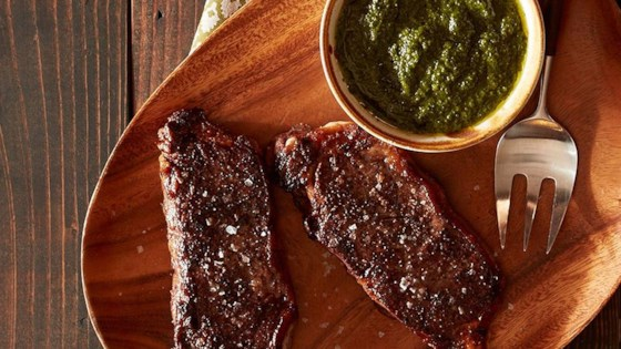 Photo of Roasted New York Strip Steak with Chimichurri Sauce by Reynolds Kitchens®