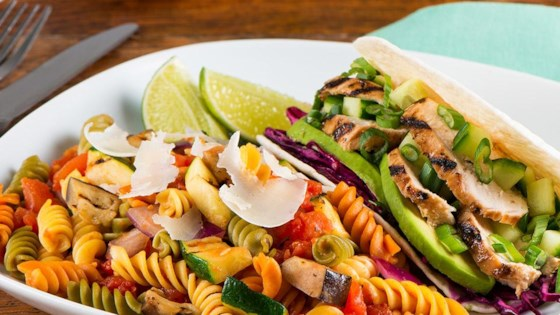 Photo of Grilled Zucchini, Eggplant and Red Onion Fusilli with Parmesan Cheese with Teriyaki Chicken Tacos by Catelli®