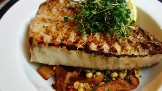 Photo of Grilled Halibut Steaks with Corn and Chanterelles  by Chef John