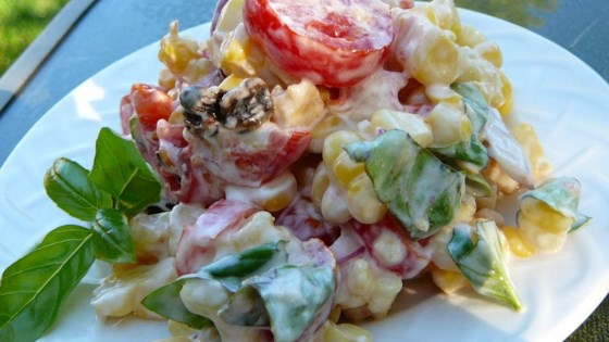 Photo of Creamy Cherry Tomato Salad with Fresh Basil, Corn and Onion by USA WEEKEND Pam Anderson
